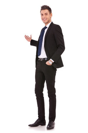 relaxed business man: Happy business man giving presentation on white background , full body picture