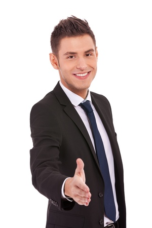 Business man offering a handshake and smiling on white background photo