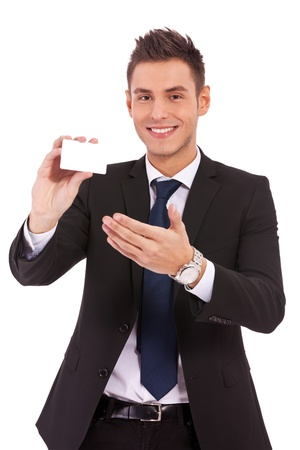 Portrait of serious business man presenting a blank card or note Stock Photo - 13311807