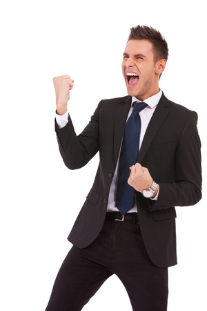 victory stand: Portrait of a energetic young business man enjoying success, screaming against white - Isolated