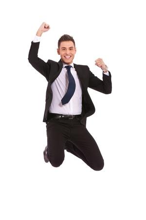 personas celebrando: El entusiasmo de los negocios - disparo aislado de un salto del hombre de negocios muy entusiasmado en el aire Foto de archivo