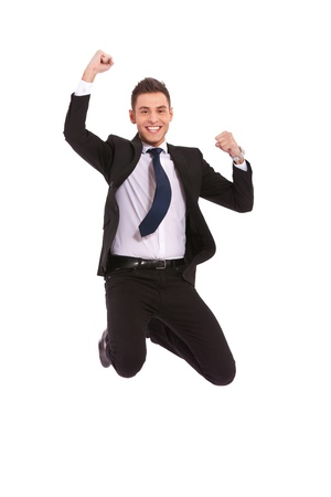 air jump: Excitement of business - Isolated shot of an extremely excited business man jumping in the air  Stock Photo