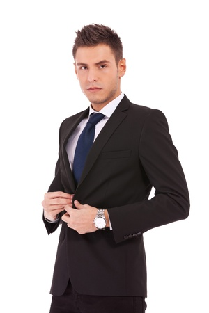 picture of a young business man buttoning his coat on whte background photo