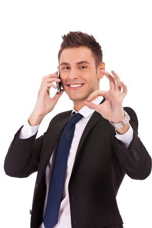 business man on the phone approving the good news, over white photo