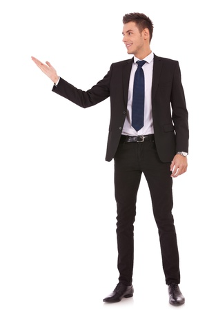 see side: Attractive business man shows you copy space on white background Stock Photo