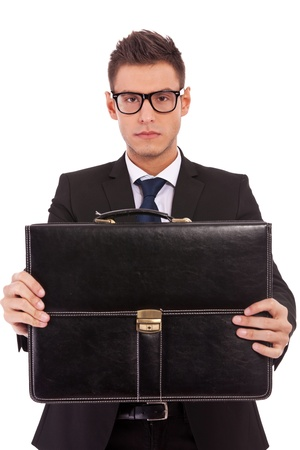 serious business man wearing glasses, offering a briefcase to you on white background photo