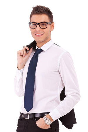 over shoulders: relaxed young business man holding coat over shoulders isolated on white background