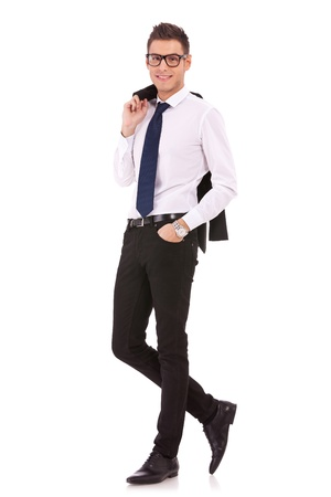 bussiness man: full body picture of a happy young bussiness man with coat on shoulder isolated on white background