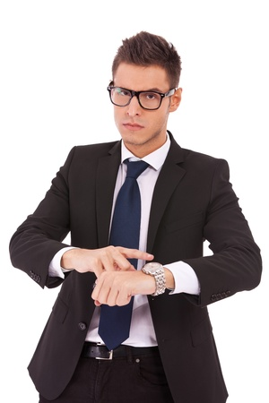 working late: angry business man showing you that you are late on white background Stock Photo