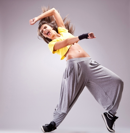 full of energy young woman dancer screaming in a beautiful dance move photo