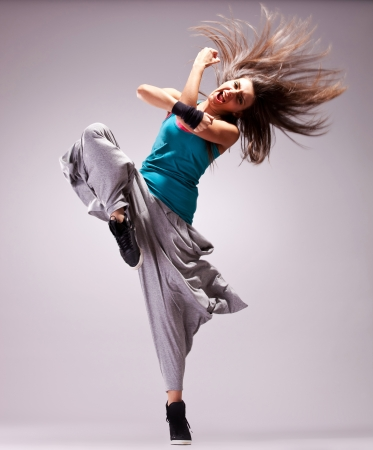 headbanging woman dancer standing on a leg in a full of energy dance move and screaming photo