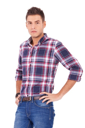 hands on hips: serious casual manwith his hands on hips over white background