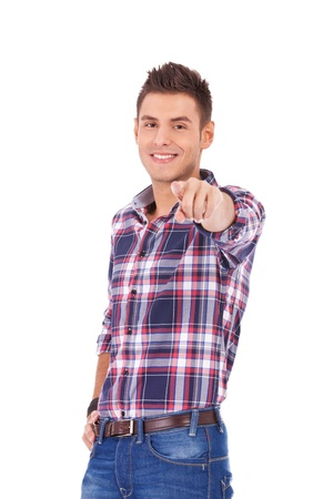 portrait of young man pointing with finger against a white background  photo