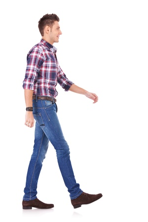side view of a fashion man walking forward over white background Stock Photo - 13618186