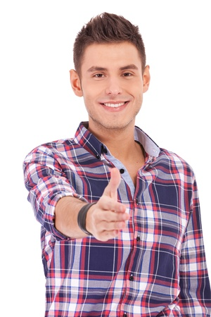 Casual Young Man Offering A Handshake on white background Stock Photo - 13618252