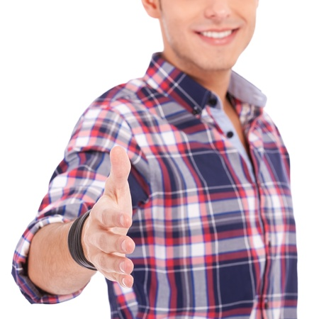 casual man with an open hand ready to seal a deal on white background Stock Photo - 13618172