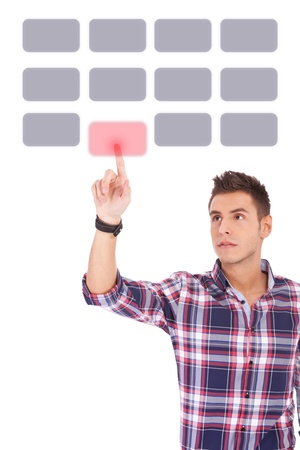 casual man pushing a button. man making a choice Stock Photo - 13618173