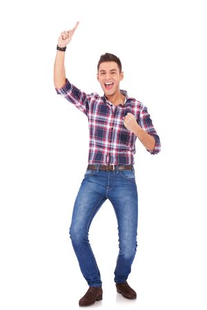 happy casual man celebrating his success isolated over a white background  photo