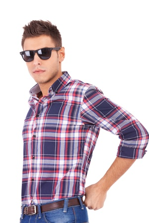 Portait of a handsome young man wearing sunglasses against white background 