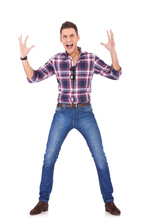 going crazy: young casual man going crazy on white background