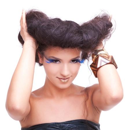 Beautiful female fashion model posing golding her hair, isolated on white background photo