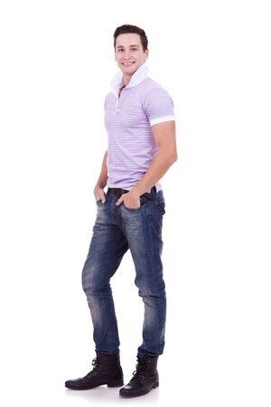 Stock image of casual man with hands in pockets isolated on white background, full shot   photo