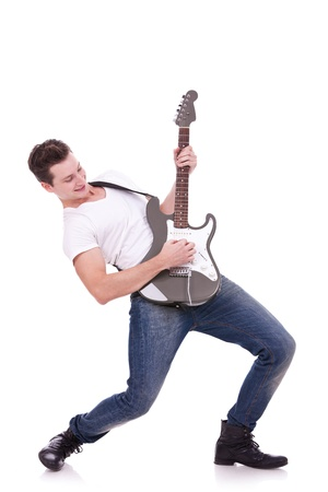 Rockstar playing solo on guitar on white background photo
