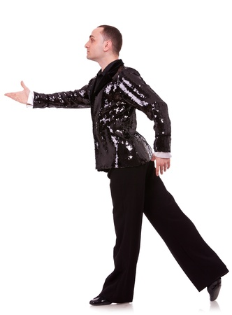 side view of a flashy male latino dancer in a pose on white background photo