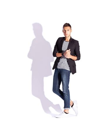 professional occupation: fashion picture of a young handsome man holding his palms together on white background with hard shadow