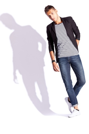 full body picture of a young fashion man on white background with hard shadow, looking at the camera Stock Photo - 13890855
