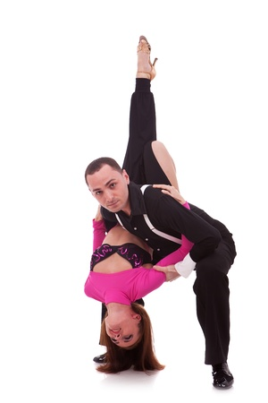 Young couple dances Caribbean Salsa, studio shot on white background