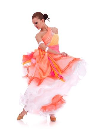 waltz: sensual waltz dancer pulling up her long orange dress on white background