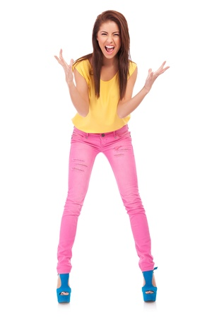 excitement: Full length portrait of happy excited girl . Over white background   Stock Photo