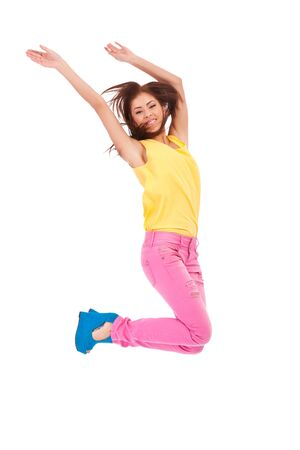 casual young excited woman  jumping in air on white background photo