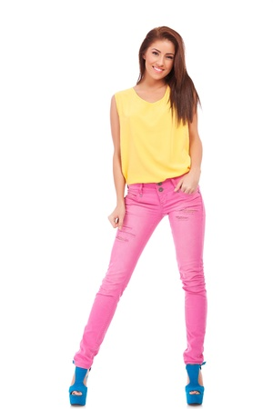 Full body young woman in casual clothes, relaxed pose, isolated over a white background.  photo