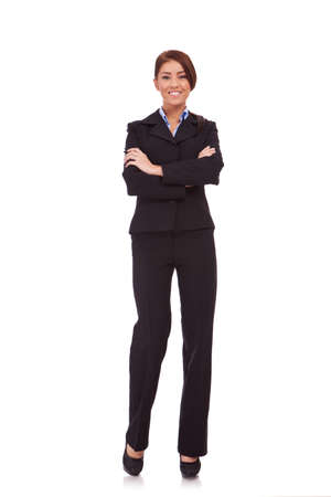 Full body portrait of business woman with crossed arms, isolated on white  photo