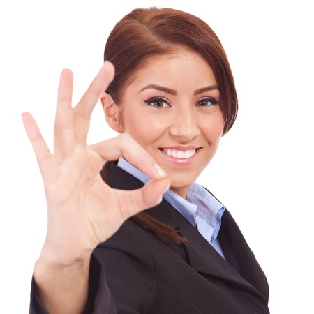 Young business woman indicating ok sign. Isolated over white background Stock Photo - 13986555
