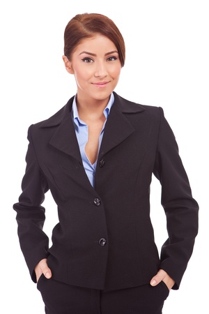 Happy young business woman with her hands in her pockets on white background photo