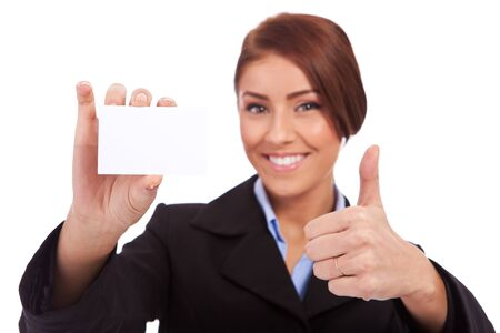 card making: business woman holding blank business card, making ok sign , focus on hands and card  Stock Photo
