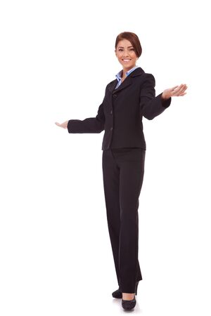Friendly smiling business woman welcoming. Isolated over white background  photo