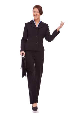 full body picture  of successful business woman walking with a briefcase and welcoming - White background Stock Photo - 13986432