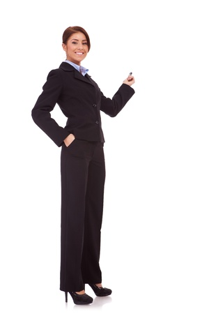 full body picture of a smiling business woman presenting something on the back with hand holding marker. Isolated over white background Stock Photo - 13986441