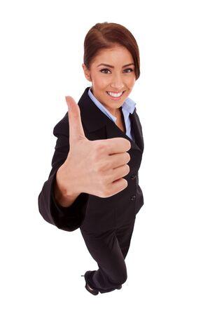 mujer cuerpo completo: Mujer de negocios exitosa aislados dando pulgares para arriba signo. Mujer de negocios en vista de ángulo alto y Foto de archivo