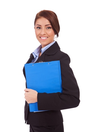 Portrait of a business woman holding a clipboard, isolated on white background Stock Photo - 13986635