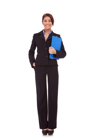 Full length young business woman standing with her clipboard isolated on white background  photo
