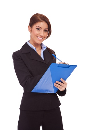 Portrait of happy smiling business woman with blue clipboard, writing, isolated on white background  photo