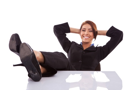 female feet: successful business woman resting at her desk on white background Stock Photo