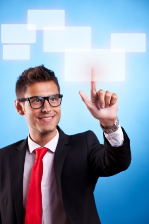 slide glass: young business man wearing glasses pressing a touchscreen button