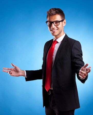suit case: Smiling business man welcoming you, on blue background