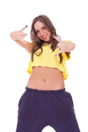 young sporty woman making the rock and roll hands gesture onwhite background